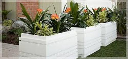 How to Arrange Outdoor Flower Planters in White