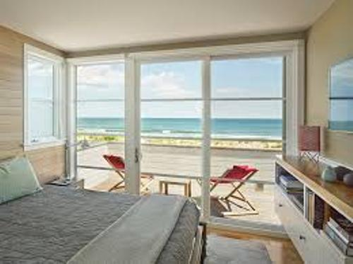 Beach Inspired Bedroom with a Lot of Windows