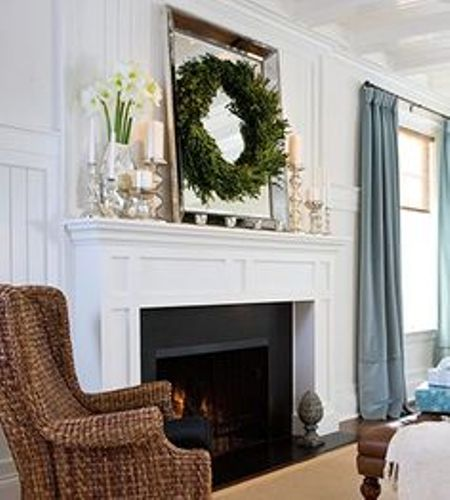 Fireplace Mantel with a Mirror and Garland