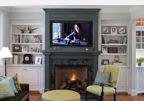 How to Decorate a Fireplace Mantel with a TV