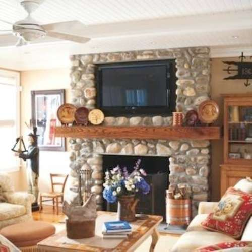 Stone Fireplace Mantel with a TV