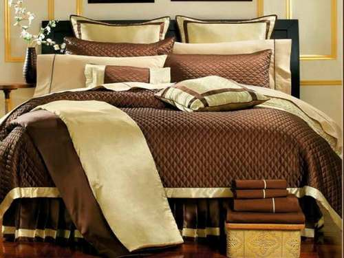 Elegant Decorative Pillows on a Bed