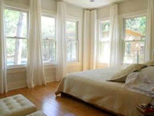 Bedroom with Lots of Windows in White