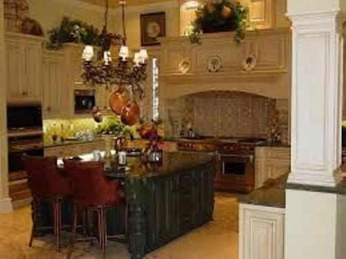 How to decorate above cabinets in kitchen 5 tips to follow home improvement day for Hanging cabinet design for kitchen