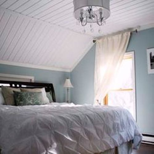 How to decorate a bedroom with slanted ceilings 5 ideas for stylish bedroom home improvement day Master bedroom with sloped ceiling