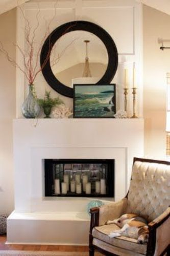 Fireplace Mantel with a Round Mirror