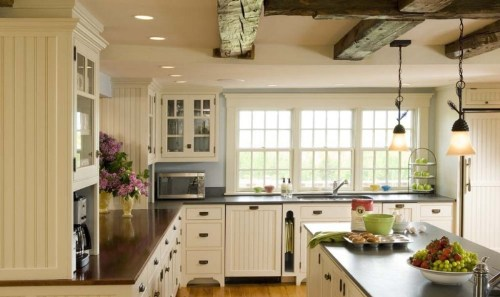 French Country Kitchen with Wooden Beam Ceiling