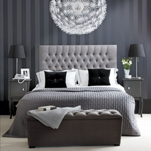 Gray Wall with Tufted Bed