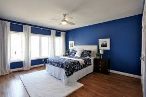 Bedroom with Blue Walls and White Curtain