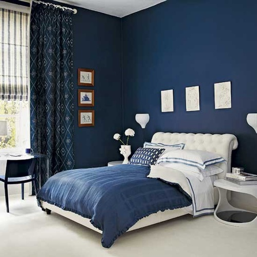 Bedroom with Blue Walls with Printed Curtain