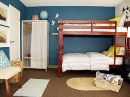 Bedroom with a Bunk Bed and Blue Wall