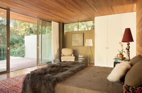 Bedroom with a Sliding Glass Door with Wooden Ceiling