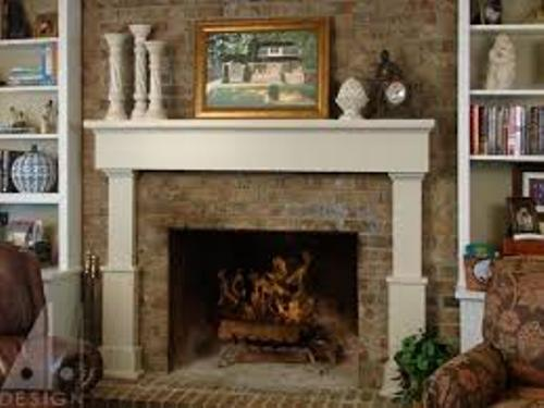 Brick Fireplace Mantel with Pictures