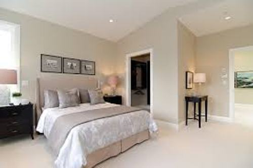 Contemporary Bedroom with Beige Walls
