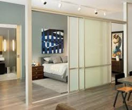 Contemporary Bedroom with a Sliding Glass Door