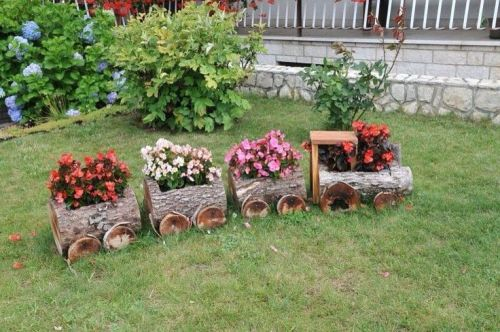 Garden with Wooden Logs and Flowers