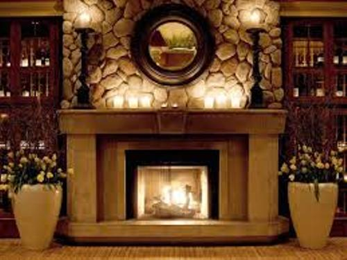 Rustic Fireplace Mantel with Stone Wall