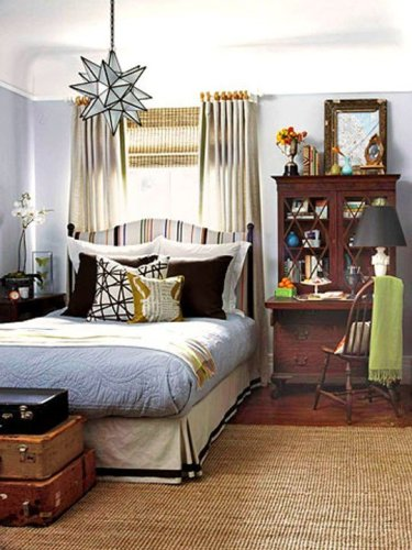 Small Bedroom with a King Bed with Wooden Dresser