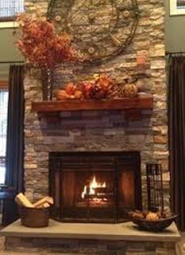 Stone Fireplace Mantel with Flowers