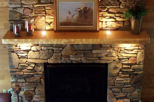 Stone Fireplace Mantel with Pictures
