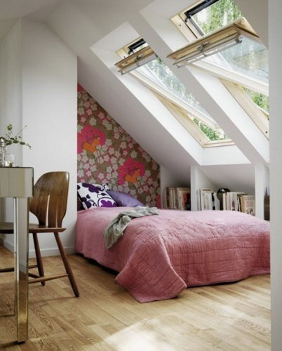 Small Bedroom with Lots of Furniture and Pink Comforter