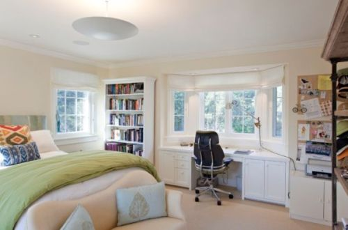 Bedroom with a Desk and Stylish Windows
