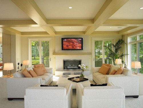Modern Living Room with TV above Fireplace