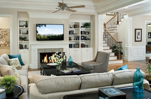 Stylish Living Room with TV above Fireplace