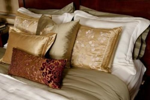 Elegant Pillows on a Corner Bed