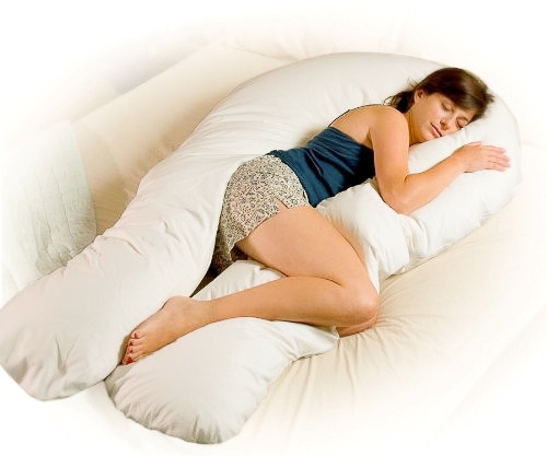 The edge of the bed sex position offers many possibilities for greater comfort during pregnancy. You can lie on the bed (on your side, or briefly on your back) at the edge of the bed and your partner can be off the bed, either on their knees or standing up.